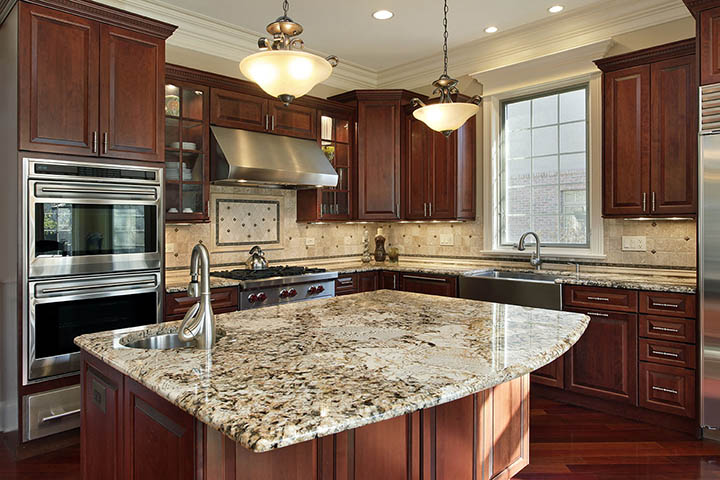 /img/gallery/granite-countertops-kitchen-radius-island.jpg